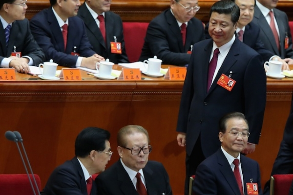 Chinese Vice President Xi Jinping walks past Chinese President Hu Jintao (front left), former Chinese President Jiang Zemin (front right) and Chinese Prime Minister Wen Jiabao (front right) during the opening session of the 18th Communist Party Congress held at the Great Hall of the People on November 8, 2012 in Beijing, China. (Photo by Feng Li/Getty Images)