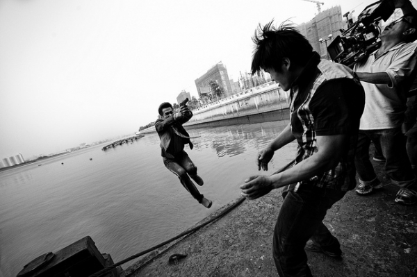 A film crew captures a climactic action scene on the harbor in Guangzhou, Guangdong, China on June 14, 2012. (Jonathan Kos-Read/Flickr)