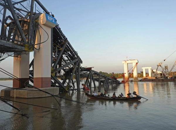 A rescue boat works near a damaged bridge in Kyauk Myaung township in central Myanmar following a 6.8-magnitude quake on Nov. 11, 2012. (Soe Than Win/AFP/Getty Images)