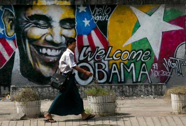 In Yangon, a Burmese man walks by a mural depicting U.S. President Barack Obama as the city gets ready for the first visit by a serving U.S. President, on Nov. 17, 2012. (Paula Bronstein/Getty Images)
