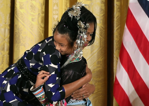 First Lady Michelle Obama hugs Lianyun Wu during an awards ceremony for the President's Committee on the Arts and the Humanities in the East Room at the White House in Washington, D.C. on November 19, 2012. (Mark Wilson/Getty Images)