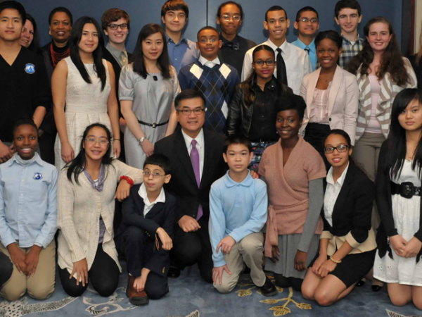 Gary Locke with Chinese language learners from secondary schools throughout the city that are a part of Asia Society's International Studies School's Network or the Confucius Classrooms Network, on Dec. 17, 2012. (Anthony Jackson)