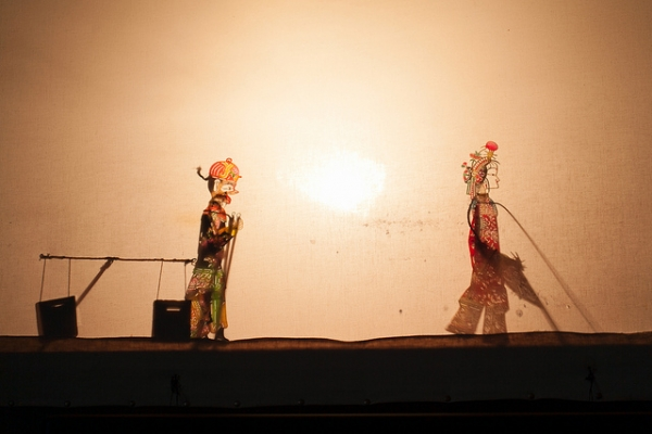A boy and a girl meet in this shadow puppet show in Xi'an, China on September 9, 2012. (Poorfish/Flickr)