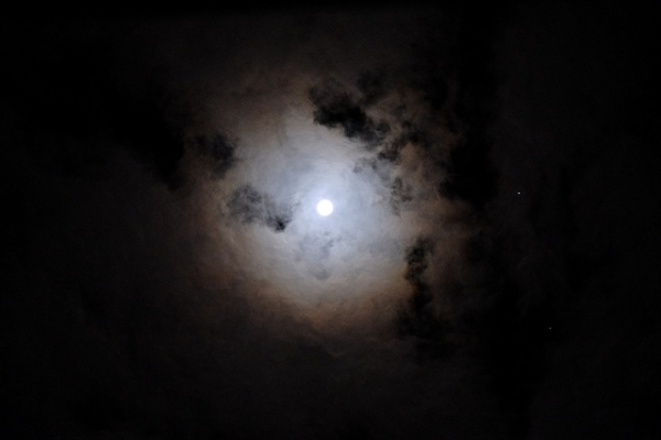 The moon shines bright on a cloudy night in Tokyo, Japan on November 29, 2012. (takuhitosotome/Flickr)