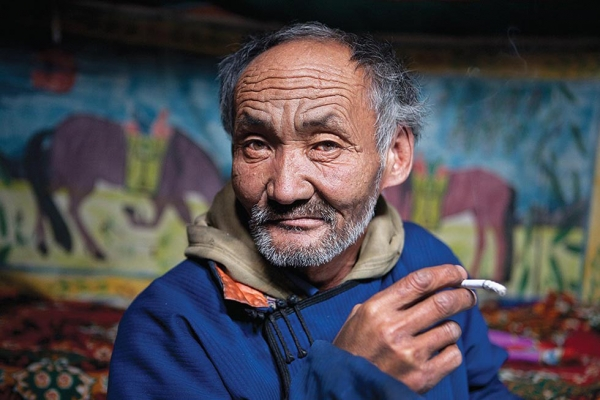 Although young men used to be given jade pipes by their fathers, most herders now smoke cigarettes. (Taylor Weidman)