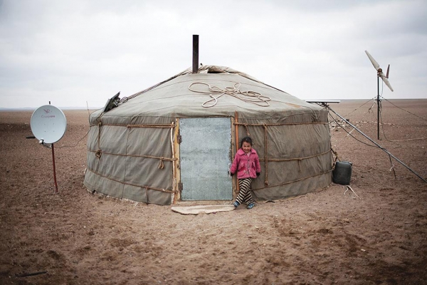 A ger (yurt) in the parched and dusty Gobi landscape near the Tavan Tolgoi coal mine. Many of the animals in the area have become sick due to the dust that has kicked up from constant truck traffic shipping coal from the mine to China. (Taylor Weidman)