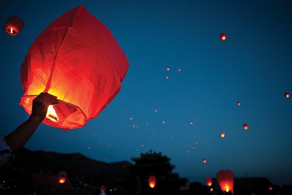 Residents of Ulaanbaatar set paper lanterns afloat at an event celebrating the birth of Buddha. (Taylor Weidman)