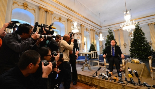 Chinese writer and 2012 Nobel Literature Prize laureate Mo Yan poses for photographers before giving a press conference in Stockholm on December 6, 2012. (Jonathan Nackstrand/AFP/Getty Images)