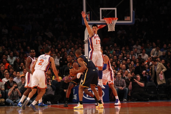 Jeremy Lin (#17) took both the United States and East Asia by a storm when he became the first American of Taiwanese descent to play for the NBA. Photographed at New York City's Madison Square Garden on March 16, 2012. (Al Bello/Getty Images)