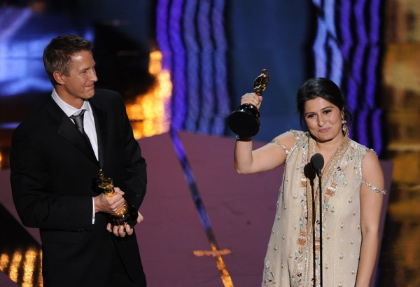 "Sharmeen Obaid-Chinoy (shown here with co-director Daniel Junge, L) became the first Pakistani to win an Oscar for her documentary short ""Saving Face"" at the 84th Annual Academy Awards  in Hollywood, California on February 26, 2012. (Robyn Beck/AFP/Getty Images)"