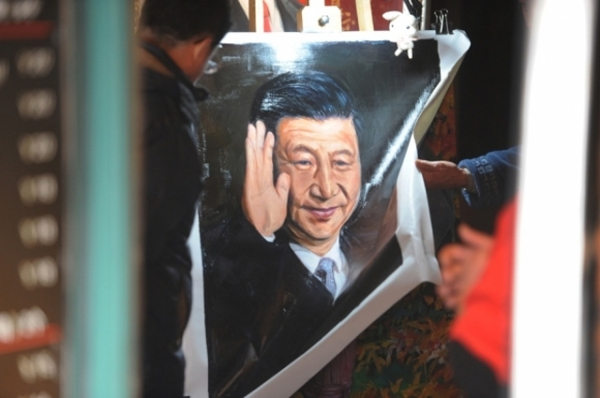 A painting of President Xi Jinping for sale in a Shanghai shop. (Peter Parks/AFP/Getty Images)