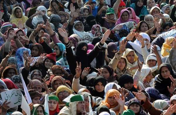 Supporters of Pakistani cleric Tahir-ul Qadri gather at a protest rally in Islamabad after the government ignored his ultimatum to disband parliament on January 15, 2013. (Asif Hassan/AFP/Getty Images)