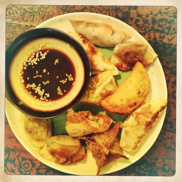 An assortment of dumplings accompanied by seasoned soy sauce for dipping. (Gigi Nguyen)