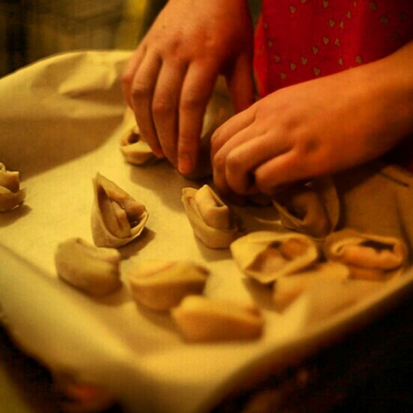 Prepping dumplings to be deep fried. (Tahiat Mahboob)