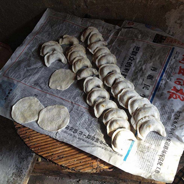 "24. ""Dumplings on top of the local newspaper."" (helene_fr)"