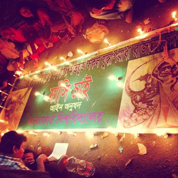Students wait around a banner from Stamford University, a private institution in Dhaka, that reads: We want a hanging. (Naorose Bin Ali)