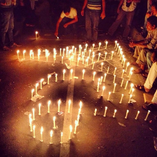 Protestors at Shahbag arrange lit candles to form the number 71 in Bangla, signifying the 1971 Bangladesh Liberation War. (Naorose Bin Ali)