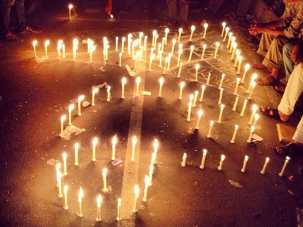 Protestors in the Shahbag area in Dhaka, Bangladesh arrange lit candles to form the number 71 in Bangla, signifying the 1971 Bangladesh Liberation War. (Naorose Bin Ali)