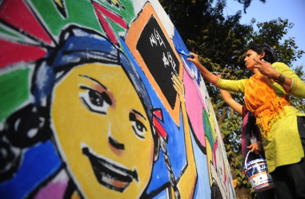 A Bangladeshi art student paints on a wall in front of the Shahid Minar in preparation for Language Martyrs Day and International Mother Language Day in Dhaka on Feb. 20, 2012. (Munir Uz Zaman/AFP/Getty Images)
