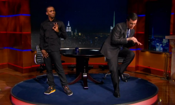 "Charles ""Lil Buck"" Riley (L) teaches Stephen Colbert how to jook Thursday, February 21, 2013, in New York."