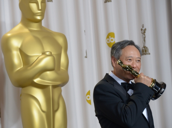 Ang Lee holds the trophy for Best Director for the movie Life of Pi in the press room during the 85th Annual Academy Awards on February 24, 2013 in Hollywood, California. (Joe Klamar/AFP/Getty Images)