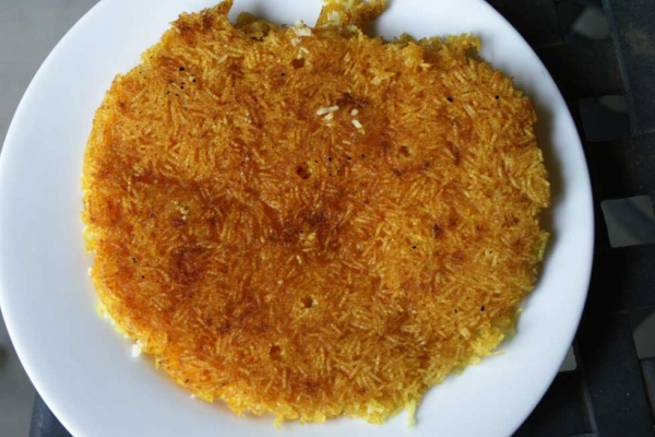 Tahdig, the buttery burnt layer of rice that is a Persian delicacy.
