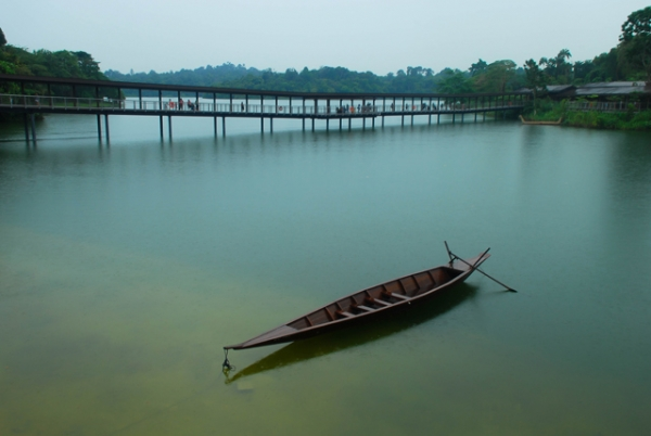 A boat is anchored in still green waters at Singapore Zoo, Singapore on April 6, 2013. (Eduardo Seastres)