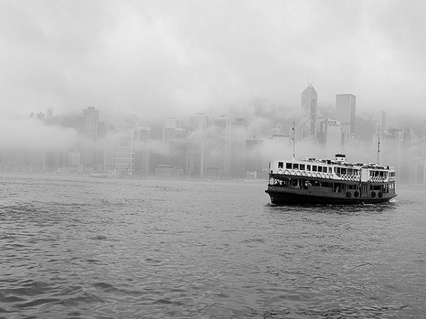 The Star Ferry sails out of the fog covering the Hong Kong Central skyline on April 21, 2013. (Cody Wms/Flickr)