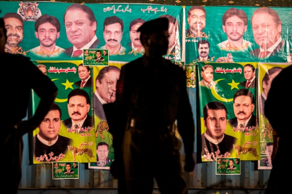 Punjab police wait for the arrival of Nawaz Sharif, leader of the Pakistan Muslim League-N (PML) party, during the final day of campaigning at an election rally in Lahore, Pakistan on May 09, 2013. (Daniel Berehulak/Getty Images)