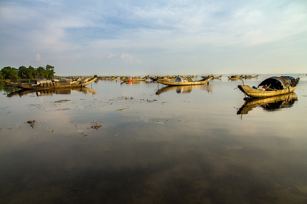 Boats remain motionless on calm waters in Hue, Vietnam on May 23, 2013. (Hoang Giang Hai/Flickr)