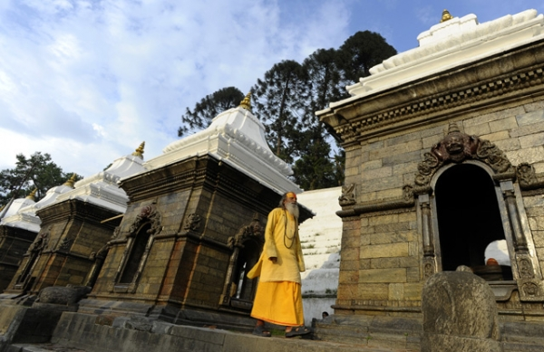 A Hindu sadhu or holy man walks on the premises of the Pashupatinath Temple in Kathmandu, Nepal on May 26, 2013. (Prakash Mathema/AFP/Getty Images)