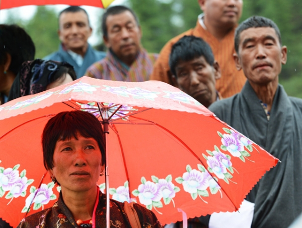A Bhutanese woman outside a polling station, waits to cast her vote in the second ever parliamentary election in Paro, Bhutan on May 31, 2013. (Roberto Schmidt/AFP/Getty Images)