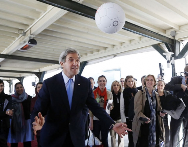 U.S. Secretary of State John Kerry heads an Afghan-made soccer ball toward the unseen captain of the Afghanistan's women's national soccer team in Kabul on March 26, 2013. (Jason Reed/AFP/Getty Images)