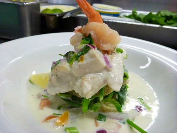 Ika Ura Vakalolo – Fijian Walu Mackerel and ocean prawns poached in local ginger, lemongrass and fresh coconut milk, with steamed taro, river spinach and coconut salsa. (lanceseeto.com)