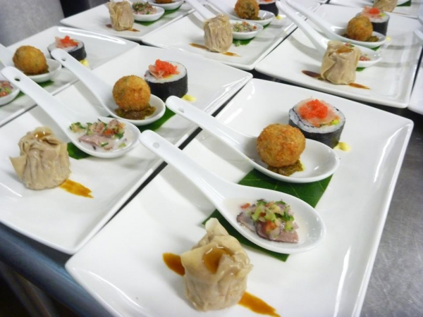Fijian Assiette plate of chicken and ginger sui mai, smoked duck in coconut salsa, Moca spinach and  mascarpone arancini and California roll with seaweed caviar. (lanceseeto.com)
