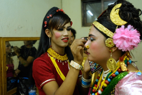Transgendered performers in colorful ornaments carefully put on make-up backstage in Kathmandu, Nepal on May 17, 2013. (Prakash Mathema/AFP/Getty Images)