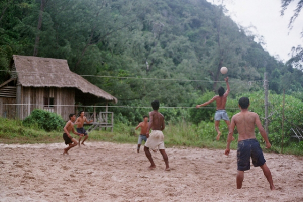 A group of boys challenge each other in a game of volleyball in Cambodia on June 6, 2013. (Dan Peiron/Flickr)