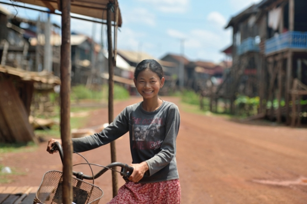 A girl and her bike in the fishing village of Kampong Khleang, Cambodia on May 4, 2013. (Jerry Donhal/Flickr)