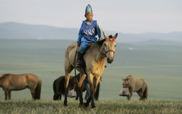 Another rider prepares for a horse race during the annual Naadam Festival at Khui Doloon Khudag 40 km from Ulaanbaatar. (Peter Parks/AFP/Getty Images)