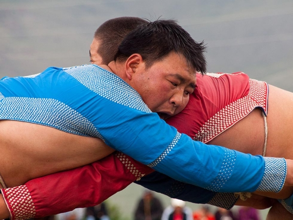 "Naadam is an important Mongolian holiday celebrated every July. Wrestling competitions are among the three main sporting ""games"" enjoyed during this festival. (Evgeni Zotov/Flickr)"