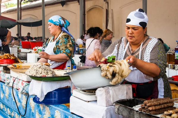 Two women hand-make traditional local cuisine in Tashkent, Uzbekistan on June 21, 2013. (Christopher Rose/Flickr)