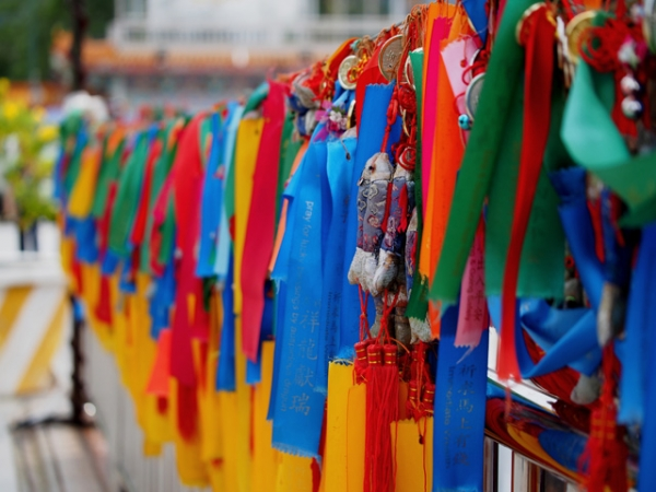 Colorful prayer ribbons and medals adorn the Kek Lok Si Temple in Penang, Malaysia on July 15, 2013. (ansel.ma/Flickr)