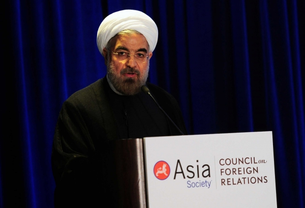 "Rouhani said that his government would leave ""no stone unturned"" in seeking a mutually acceptable solution to the impasse surrounding Iran's nuclear program. (Emmanuel Dunand/AFP/Getty Images)"