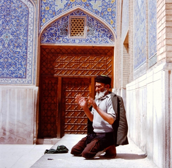 A man in the midst of his prayers.