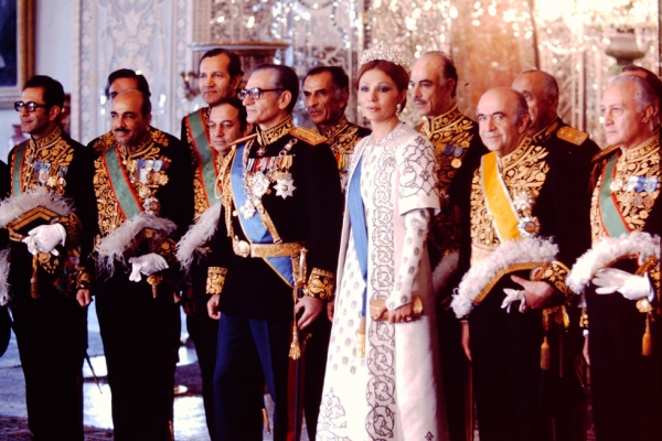 The Shahanshah Mohammad Reza Pahlavi and Shahbanu Farah Pahlavi at a court reception surrounded by the Shah's ministers of state.