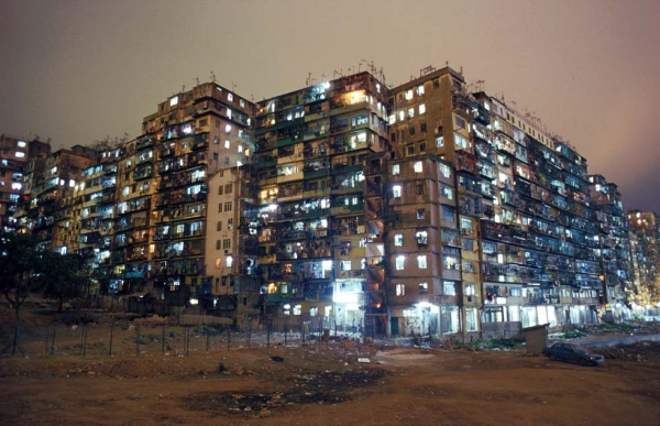 Lights illuminate the Kowloon Walled City at night. Originally a Chinese fort, the Walled City became a crowded residential dwelling after the British occupation of Hong Kong, and was ultimately demolished in 1993. (Greg Girard)