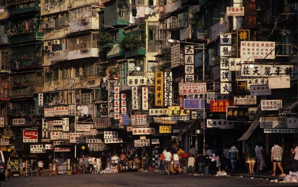 Street life was often bustling outside the Kowloon Walled City. Today, traces of the Walled City's characters remain in the surrounding neighborhoods, said Girard. (Greg Girard)