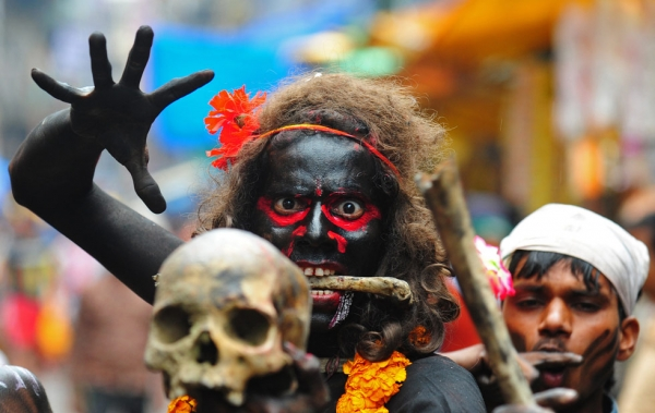 A Hindu devotee holds a human skull during a procession for Maha Shivaratri, dedicated to the Hindu god Lord Shiva, in Allahabad, India on February 27, 2014. (Sanjay Kanojia/AFP/Getty Images)