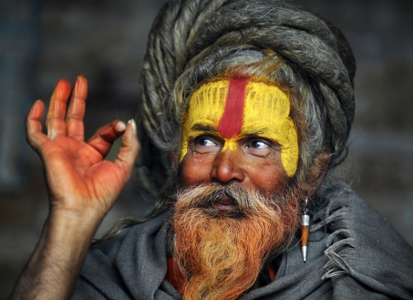 A Hindu Sadhu (holy man) poses for a photograph during the Maha Shivaratri festival at the Pashupatinath temple in Kathmandu, Nepal on February 27, 2014. Hindus mark the Maha Shivratri festival by offering special prayers and fasting to worship Lord Shiva, the lord of destruction. (Prakash Mathema/AFP/Getty Images)