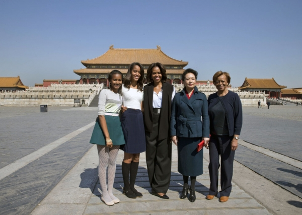 U.S. First Lady Michelle Obama (C), her daughters Sasha (L), Malia (2nd L), her mother Marian Robinson (R) and Peng Liyuan, wife of Chinese President Xi Jinping, pose for photographers in Beijing's Forbidden City on March 21, 2014. The Obamas arrived in Beijing to kick off a seven-day, three-city tour meant to focus on education and cultural exchange. (Andy Wong/AFP/Getty Images)